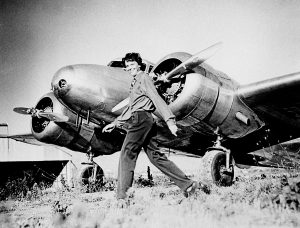 Amelia Earhart, who served as a consultant in the Department of the Study of Careers for Women at Purdue from 1935 to 1937, strides past her Lockheed Electra. Sally Putnam Chapman has donated 492 Earhart items Ñ including rarely seen personal and private papers such as poems, a flight log and a prenuptial agreement Ñ to Purdue Libraries' Earhart collection. (File photo) A publication-quality photograph is available at ftp://ftp.purdue.edu/pub/uns/earhart.newdocs/earhart.electra.jpeg.